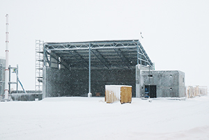 PCC BakkiSilicon - The wood chip storage facility has been nearly completed, only a few cladding elements are still missing.