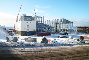 PCC BakkiSilicon - View of the second terrace (production): Front left: the main electrical station Front centre: the electrode storage Background centre: the furnace building Background right: warehouse for the finished product Front right: the cooling water station