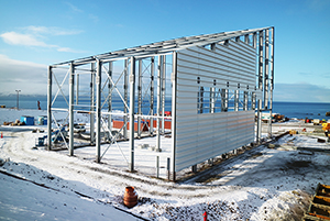 PCC BakkiSilicon - Steel structure construction on the product packaging hall has been completed, cladding work is in progress.