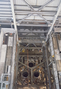 PCC BakkiSilicon - Interior view of the furnace building. The openings into the furnace vessel for the three electrodes are visible (from above)