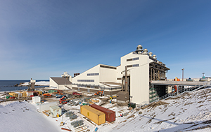 PCC BakkiSilicon - Overview of the second terrace. The daily depots securing the feedstock supply are in the front, while the furnace building is visible in the background.